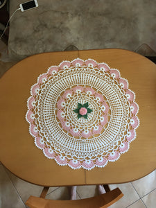 Crocheted white doily with flowers