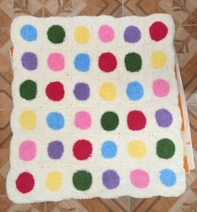 Crocheted baby blanket with colored circles