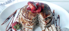 Pancakes Drizzled with Date Syrup and Topped With Strawberry