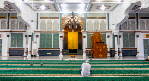 A Man Worshipping By Sitting in Masjid