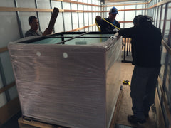 custom aquarium being loaded on a box truck for shipping