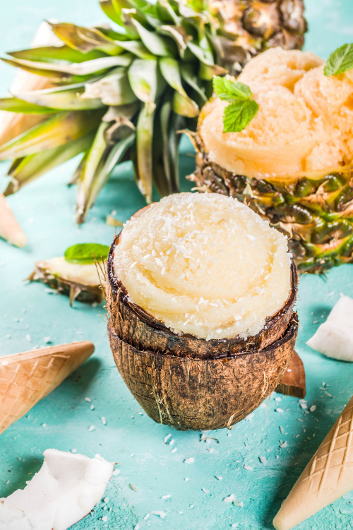 pineapple coconut ice cream scoop in a coconut shell