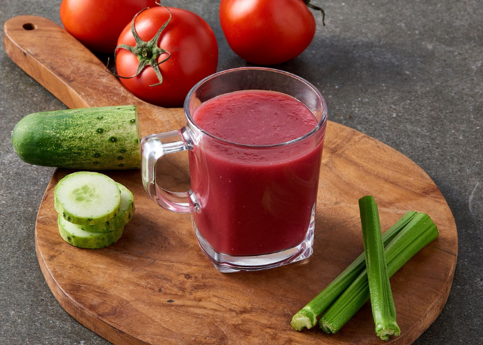 vegetable juice with cucumber, tomatoes, and celery