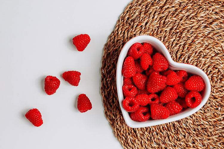 Kuvings red raspberries in a heart-shaped bowl