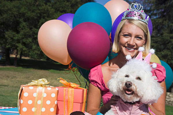 woman celebrating her birthday with her dog
