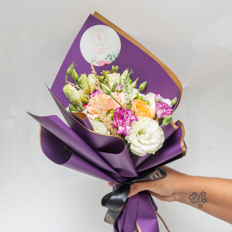 Purple and gold papel wrap bouquet