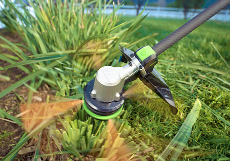 "Power+ 15"" 56V Lithium-Ion POWERLOAD™ String Trimmer w/ Carbon Fiber Split Shaft lifestyle"