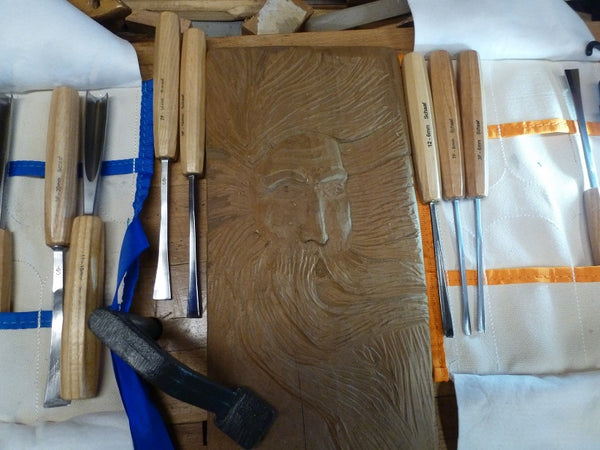 types of wood carving, relief carving, carving spirits, chip carving art by Mike Evans