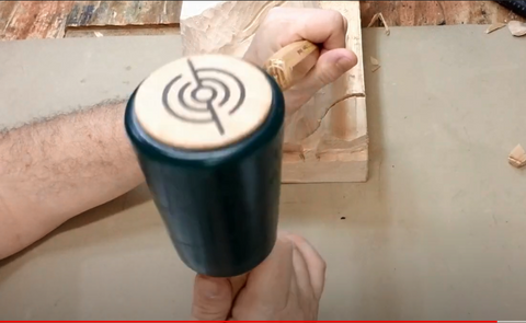 you can even hold a carver's mallet with just your wrist or your fingers