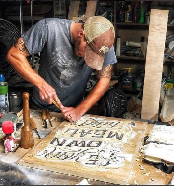 Ryan Rowicki relief carving a sign with Schaaf Tools Foundation Set