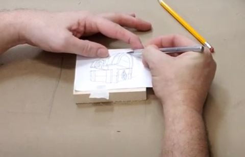 Go over the carving pattern with your metal stylus