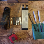 Sharpening stone next to tools