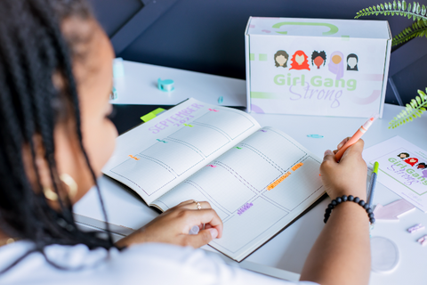 image of girl writing in planner