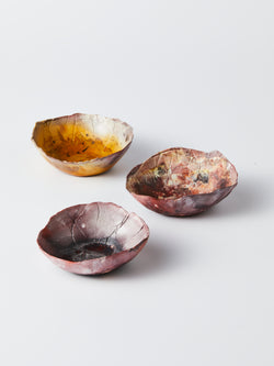 Three small unique bowls