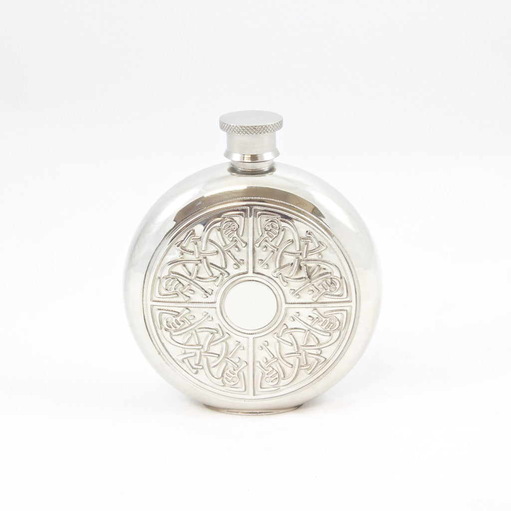 Round flask with celtic knots engraved on front.  Pewter; made in England