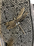 Dragonfly pinned to celtic scarf