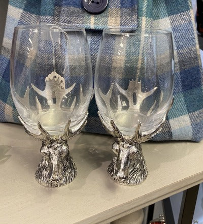 Wine glasses sitting on solid pewter stag base