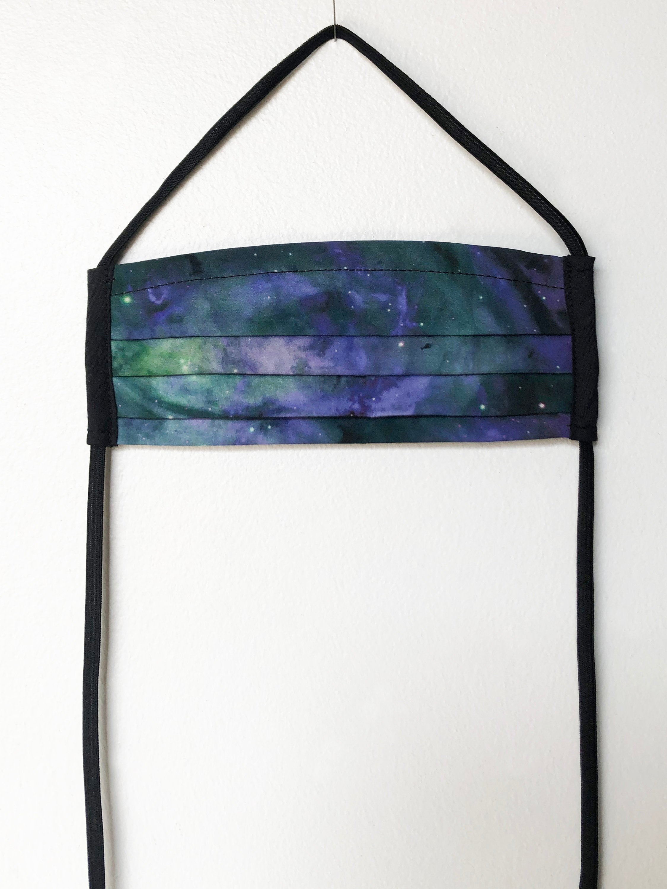 galaxy print - outer space - pleated face mask // face covering - 2 cotton layers - green and purple - washable and reusable