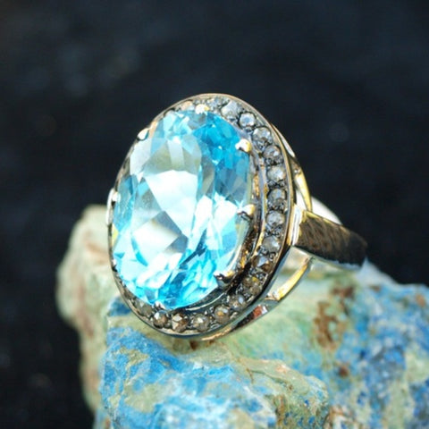 Amazing Blue Topaz and Diamond ring. Size 8