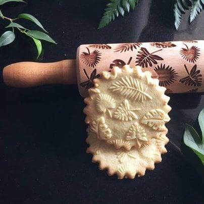 embossed rolling pin and cookies