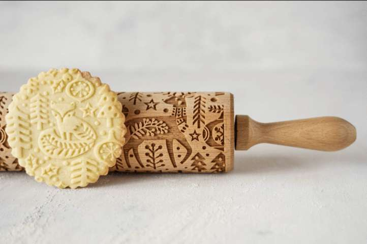 Christmas rolling pin and a cookie