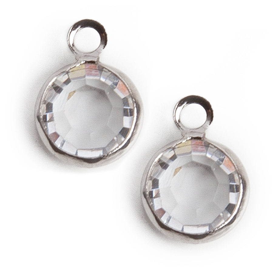 clear iridescent crystal charm in a stainless steel setting with loop on top