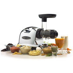 Omega J8006 Juicer with juice and more delicious treats.