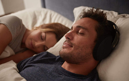 man with sleep headphones