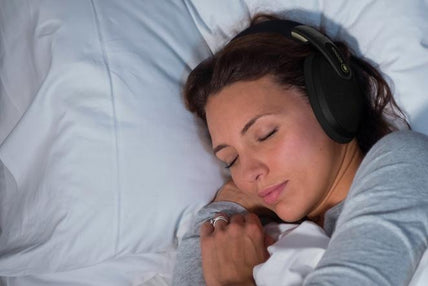 woman with sleep headphones