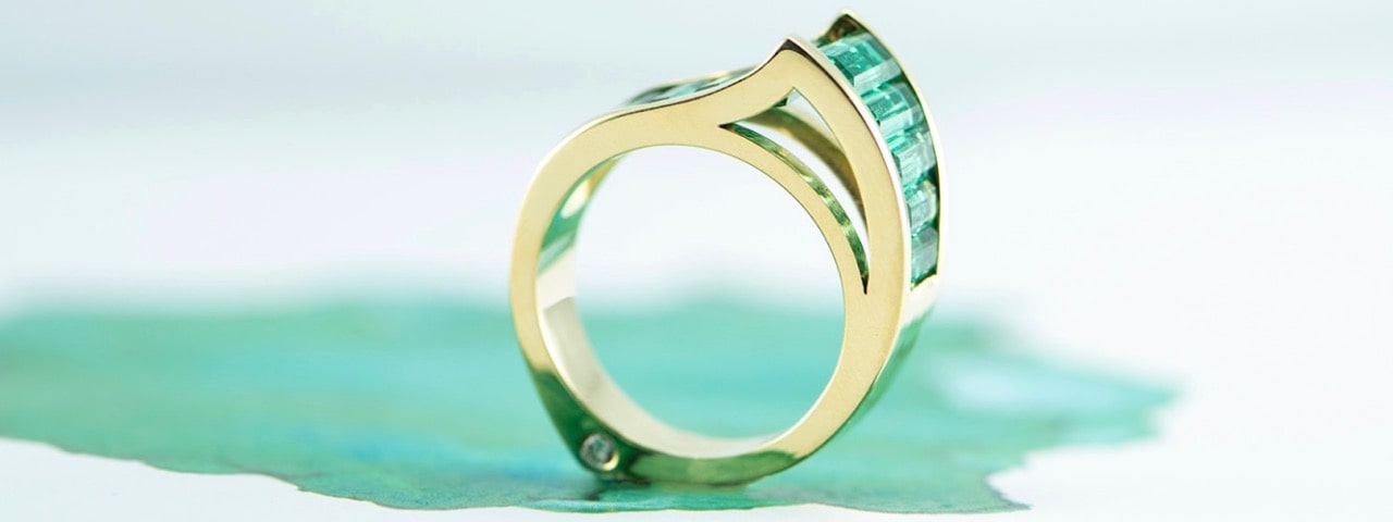 Designer Emerald channel ring made by Canterbury Jewellers of Christchurch NZ