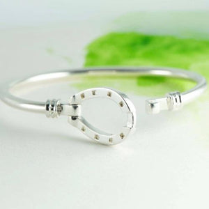 Large horse shoe bangle in Sterling Silver