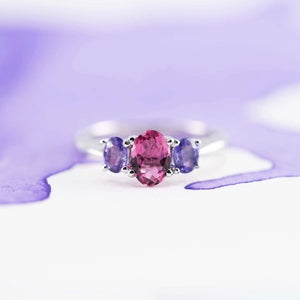 Front view of a delicate Cathedral ring showing a pink tourmaline and lavender Sapphires set in 18ct white gold hand made in New Zealand