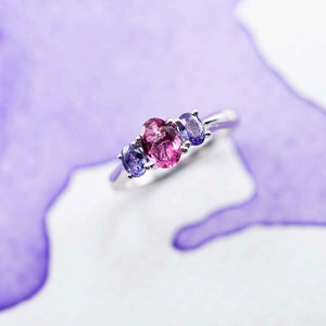 Top view of a delicate Cathedral ring showing a pink tourmaline and purple Sapphire 18ct white gold ring hand made in New Zealand