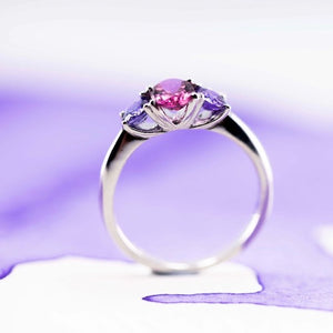 Side view of a delicate Cathedral ring showing a pink tourmaline and lavender Sapphire 18ct white gold ring hand made in New Zealand