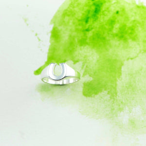Small horse shoe signet ring in Sterling Silver