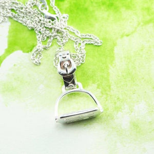 New Zealand silver stirrup pendant on a chain