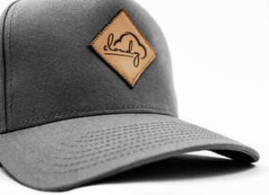 "Curved Snapback ""cloudy"" grey/ leather patch"