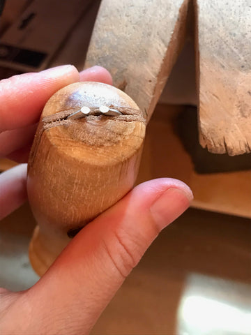holding the white gold shank in a ring vice