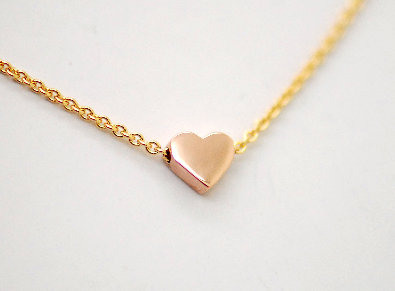 14K tiny rose gold heart on yellow gold chain
