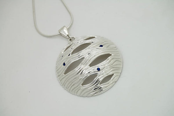 Large circle statement necklace: chunky silver pendant with sapphire accents - Fine Jewelry by Anastasia Savenko