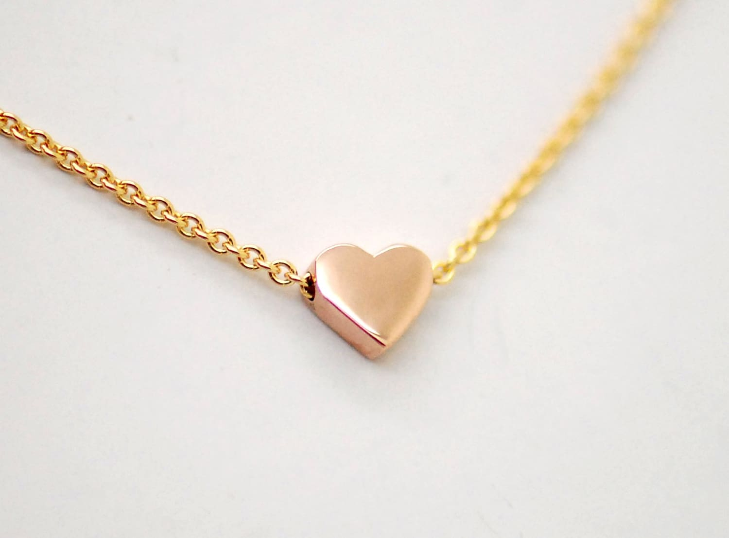 3596b79a2 14K tiny rose gold heart on yellow gold chain. 14k solid gold three hearts  necklace ...