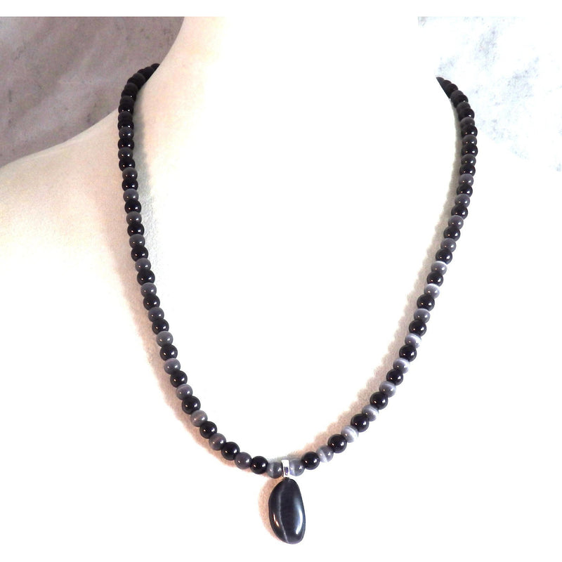 black catseye pendant on a bust