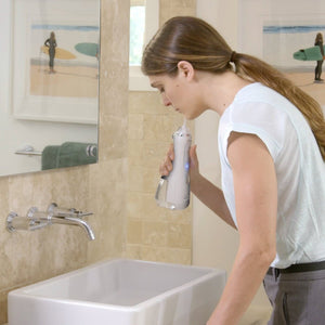 Waterpik WP-560UK Cordless Advanced Water Flosser - White Edition (UK 2-Pin Bathroom Plug)