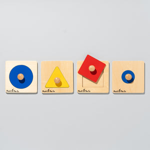 The four single shape puzzles lined up. Large circle, triangle, square, small circle
