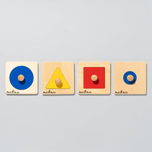 four single shape puzzles. Blue large circle, yellow triangle, red square, blue small circle