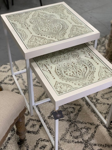 White carved nest side tables
