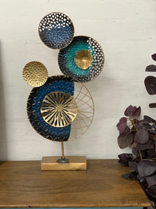 Metal art on stand- blue & gold