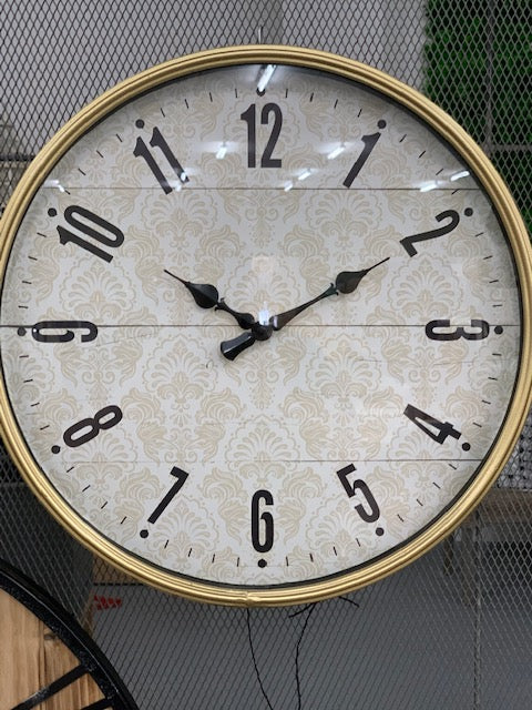 Gold rimmed clock- glass face