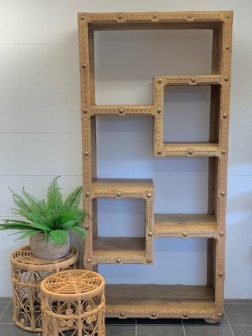 Carved bookshelf with studding