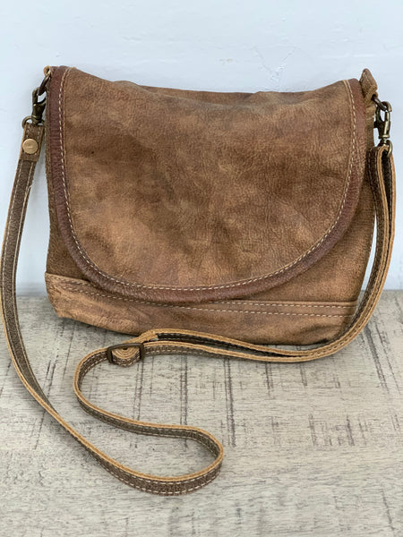Leather sling bag with flap